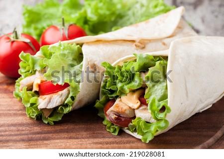 Chicken fajita wrap sandwich - stock photo