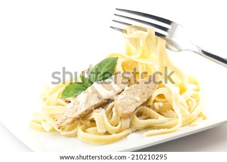 Chicken Fettuccini alfredo with fresh basil leaves, delicious - stock photo