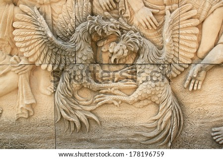 Chicken Fighting, Temple Wall Decoration. Thailand - stock photo
