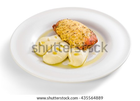 Chicken fillet in Dijon and mashed potatoes in a plate on a white background