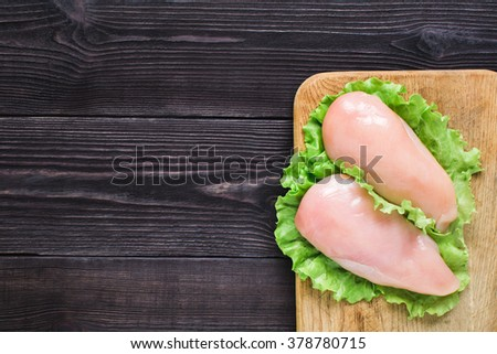 Chicken fillet on a cutting board. Top view.