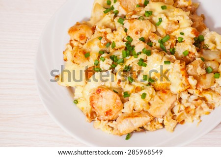 chicken fillet with cauliflower baked with egg and cheese - stock photo