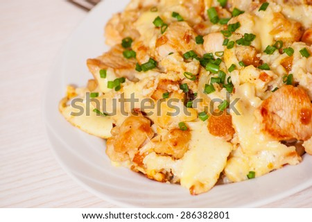 chicken fillet with cauliflower baked with egg and cheese