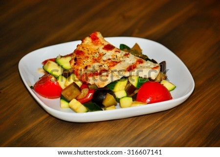 Chicken fillet with grilled vegetable - stock photo