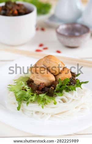 Chicken fillet with onion chutney and rice noodles - stock photo