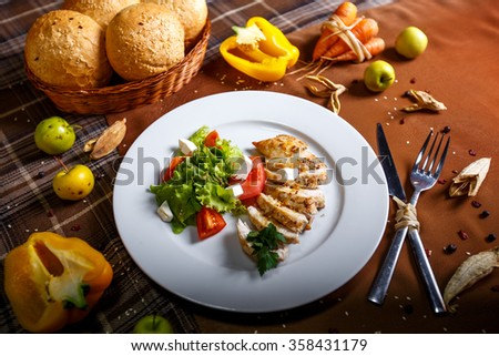 chicken fillet with vegetables and greens