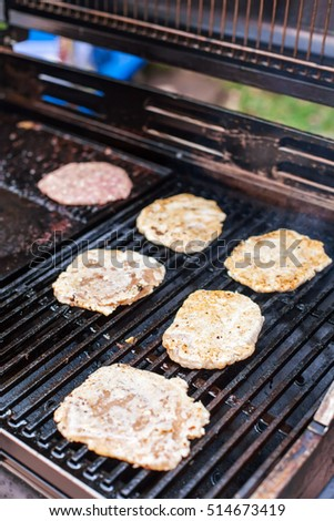 Chicken for burgers, grilling on Barbecue Stove