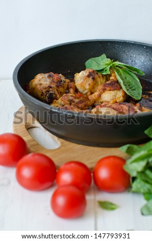 chicken fricassee in a frying pan - stock photo