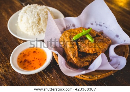 Chicken.Fried Chicken.Closeup Chicken.Food Chicken.Cooking Chicken.Spicy Chicken.Thailand Chicken.Cooked Chicken.Tasty Chicken.Meal Chicken.Calories - stock photo