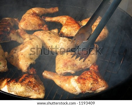 Chicken grill at a family garden party in the summer. - stock photo