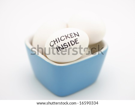 Chicken inside - white eggs in blue cup