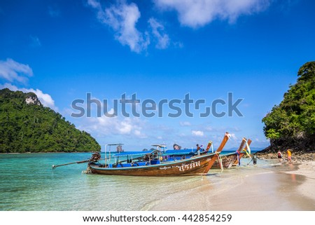 Chicken Island, Thailand - June 12th 2016 - Traditional Thailand boat in a amazing beach in Chicken Island in southern Thailand.