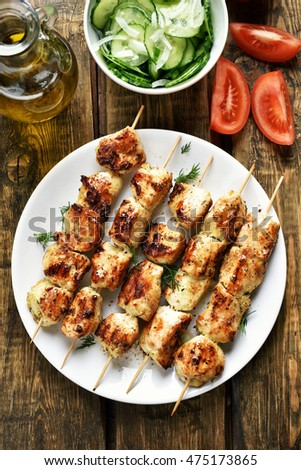 Chicken kebab and vegetables, country style, top view