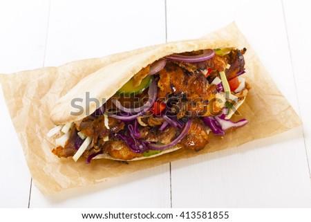 Chicken Kebab on a bun - stock photo