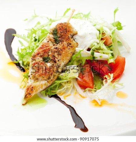 Chicken Kebab on Fresh Vegetables Salad with Homemade Sour Cream - stock photo