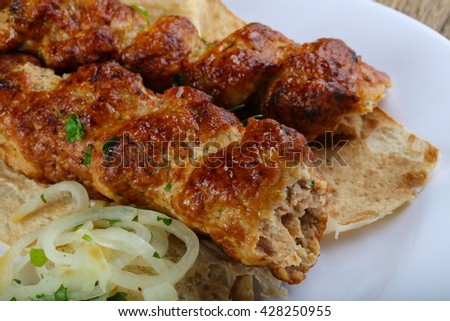 Chicken kebab with onion, parsley and bread