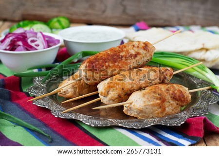 Chicken kebab with vegetables, sauce and pita - stock photo