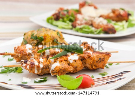 Chicken kebabs and wings in sour cream - Indian cuisine - stock photo