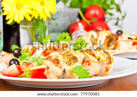 Chicken kebabs served with salad. - stock photo