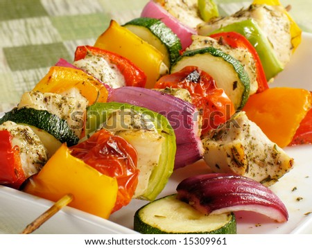 Chicken kebabs with bell peppers, onions, zucchini, and cherry tomatoes - stock photo