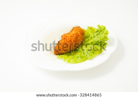 Chicken Kiev on white plate isolated on white background - stock photo