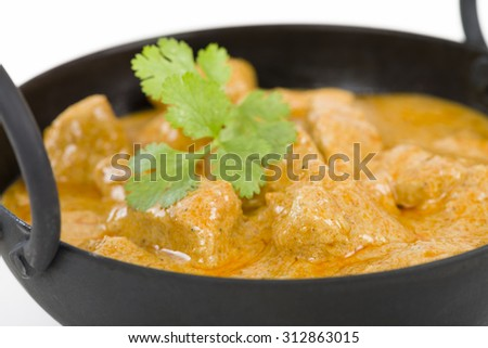 Chicken Korma - Chicken on a mildly spiced creamy sauce. Indian cuisine. - stock photo