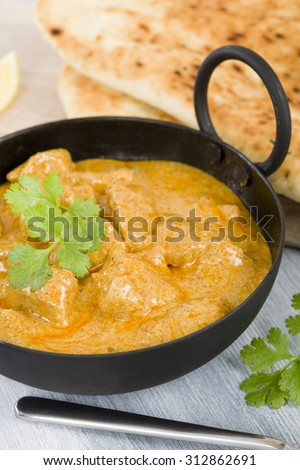 Korma - Chicken on a mildly spiced creamy sauce served with naan bread ...