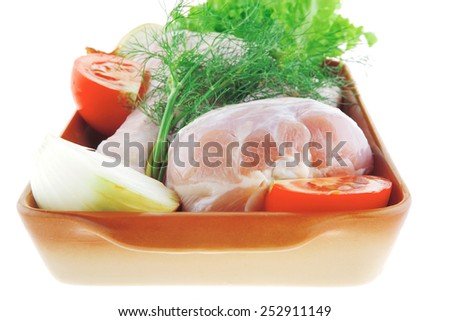 chicken leg and vegetables over white background - stock photo