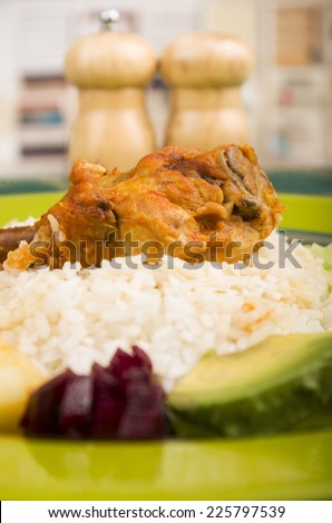 chicken leg served with white rice avocado beetroot on a plate - stock photo