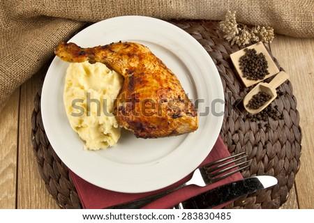 Chicken leg with potato puree concept background - stock photo