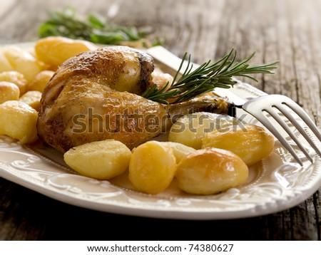 chicken leg with potatoes - stock photo