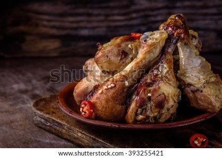 chicken legs baked with spicy sauce with red chili pepper