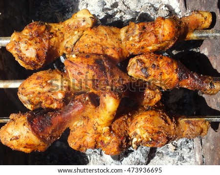 chicken legs in frying