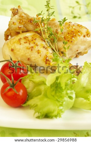 Chicken legs in sauce from mustard and honey