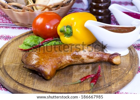 chicken legs on a table in a restaurant - stock photo