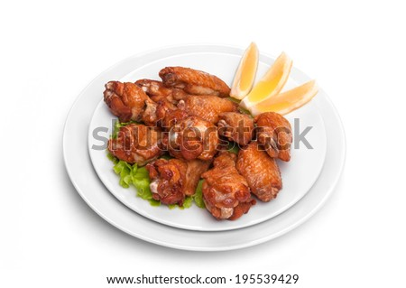 chicken legs on white plates - stock photo