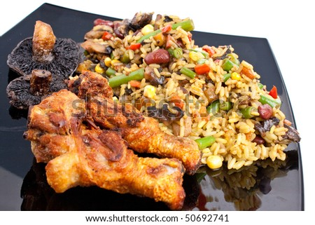 Chicken legs with curry rice and vegetables
