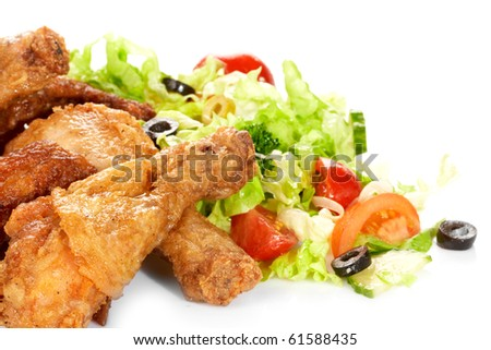 Chicken legs with fresh vegetables - stock photo