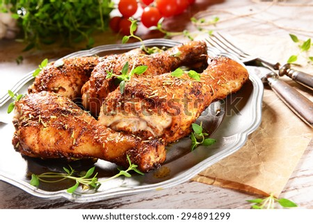 Chicken legs with thyme - stock photo