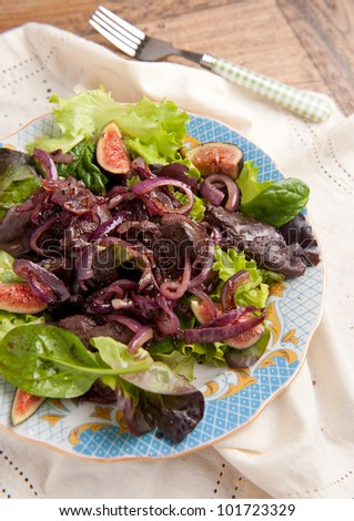 Chicken liver and fig salad - stock photo