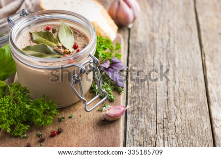 chicken liver pate in glass jar, selective focus, copy space - stock photo