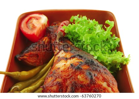 chicken meat and vegetables with red peppers