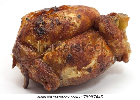 chicken meat cooked on a spit in the rotisserie