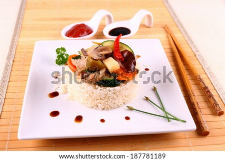 Chicken meat, rice, zucchini, carrots, sauces, close up - stock photo