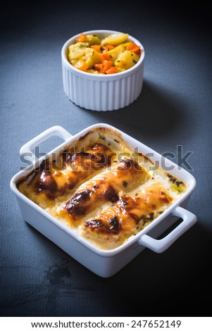Chicken meat stuffed with cheese and ham,selective focus on the front bowl - stock photo