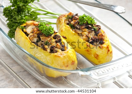 chicken meat with black beans baked in potatoes