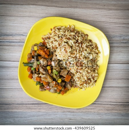 Chicken meat with fried rice and steamed vegetables. Serving food. Food theme. International cuisine. Close up. Lunch menu. One portion. - stock photo
