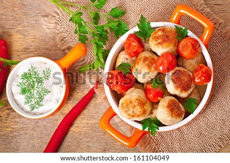 Chicken meatballs with cherry tomatoes - stock photo