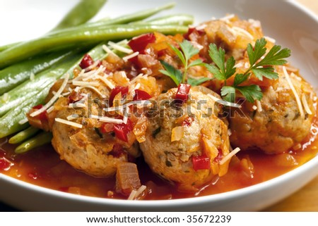 Chicken meatballs with green runner beans.  Simmered in a rich herbed tomato sauce, and topped with parmesan and parsley.