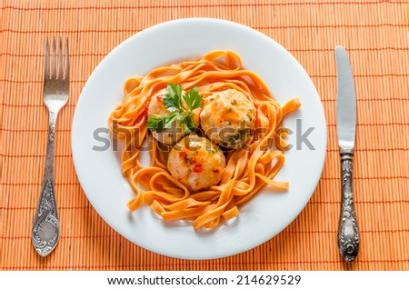 Chicken meatballs with pasta - stock photo